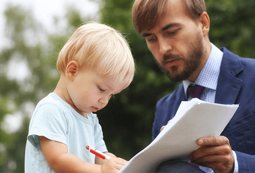child signing legal papers